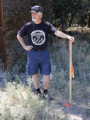 Michael Darmody stands next to a survey marker in Berg Park East in Farmington as he prepares for the beginning of his new project this weekend.