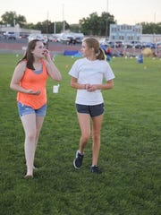 Maddison Trotter, left, and Clara Vander Hoven take part in Saturday's Relay for Life at the Boys & Girls Clubs of Farmington football field.