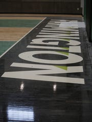 The sunken basketball floor in the new Farmington High School gym is just one of the building's eye-catching features.
