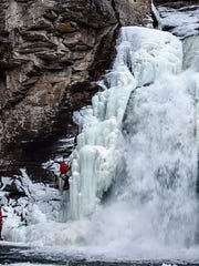 Anthony D'Ercole climbs Linville Falls off the Blue Ridge Parkway Saturday, Jan. 6. He is believed to be the first to lead climb the towering waterfall.