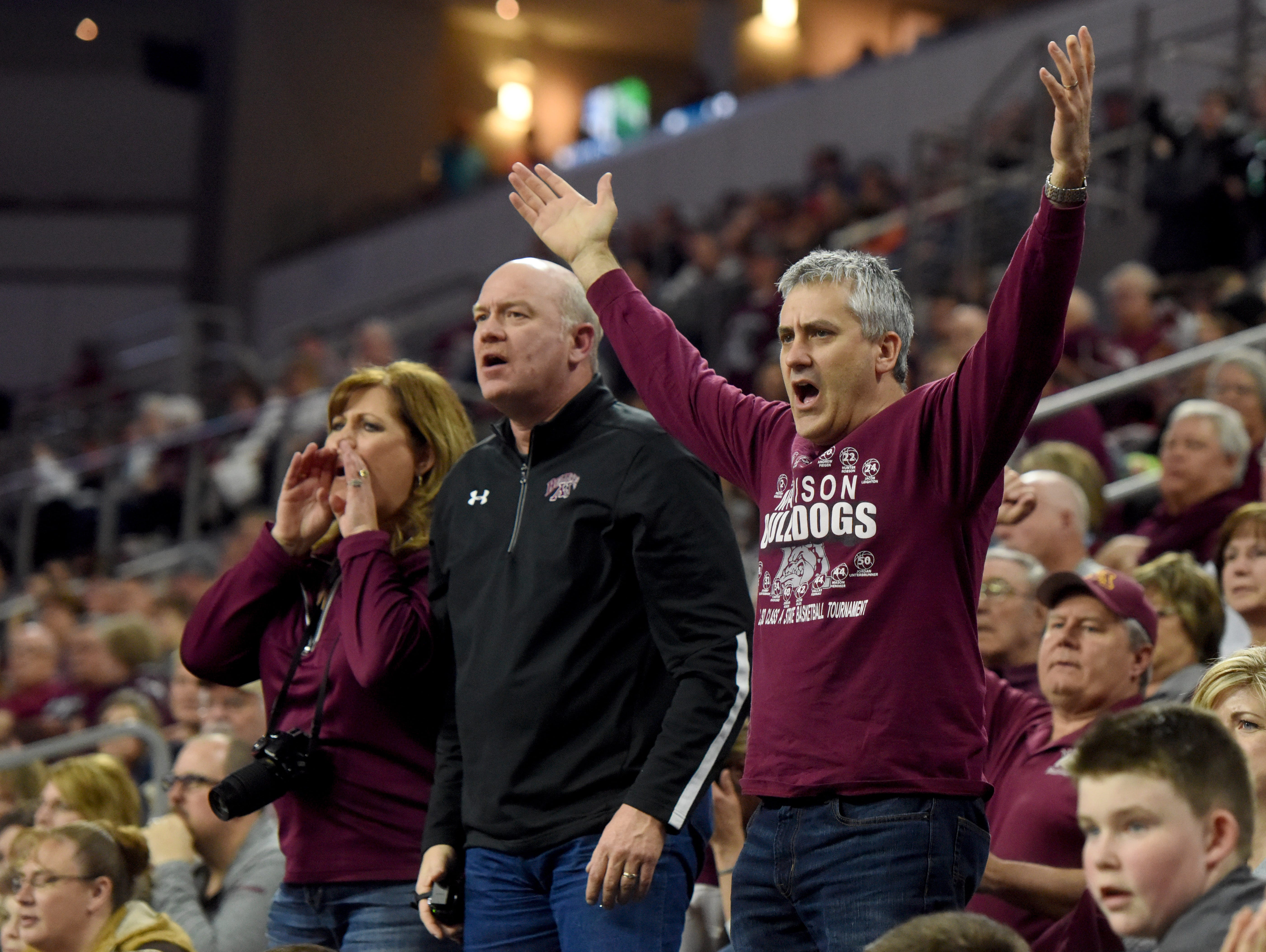Madison fans react to a ref's call against Tea Area during the 2017 SDHSAA Class A boy's basketball championship at the Denny Sanford Premier Center on Saturday, March 18, 2017.