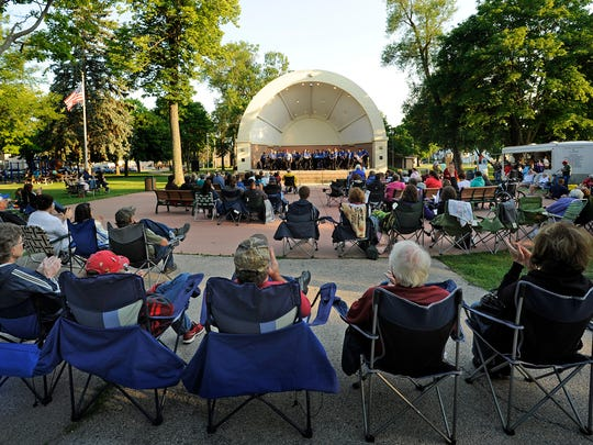 File - Audience members pack Washington Park in Manitowoc