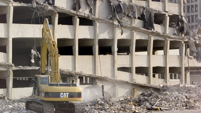 A bulldozer demolished a parking garage at Seventh and Mulberry streets in downtown Des Moines in 2004.