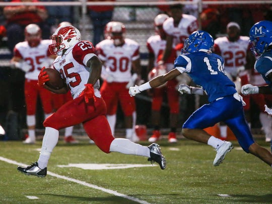 Smyrna running back Will Knight, shown here on a 60-yard touchdown run against Middletown, has 468 rushing yards and seven TDs in two games.