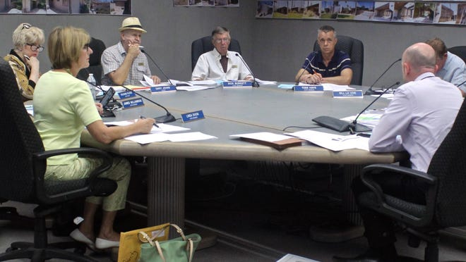 Palm Springs Historic Site Preservation Board members discuss issues on their agenda during a recent meeting.