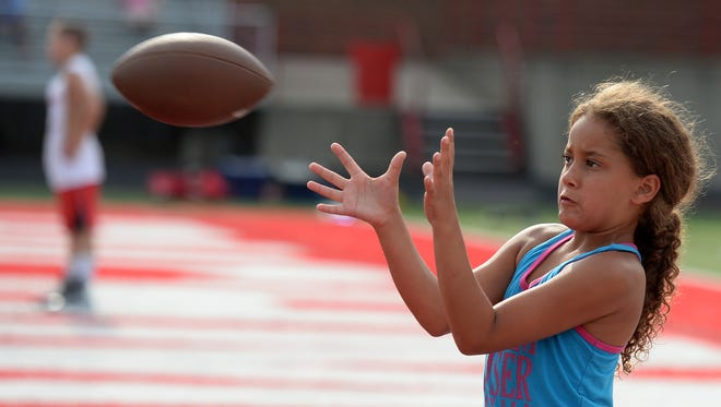 Kids participate in the Richmond High School youth football camp Wednesday, July 20, 2016, at Lyboult Field at RHS.