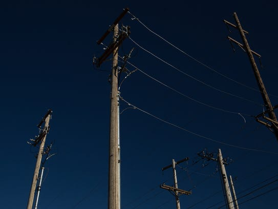 Utility lines run near an electric substation in Aztec,