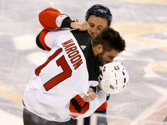 Florida Panthers center Micheal Haley (18) and New Jersey Devils left wing Patrick Maroon (17) fight during the first period of an NHL hockey game Thursday, March 1, 2018, in Sunrise, Fla.