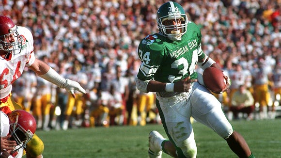 Running back Lorenzo White pounded defenses in the 1987 season for more than 1,500 yards. Here, he scored the Spartans' first touchdown in their Rose Bowl win over USC.