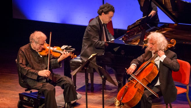 Violist Itzhak Perlman (left), pianist Evgeny Kissin (center) and cellist Misha Maisky perform at The Grand Opera House in Wilmington on Tuesday night.