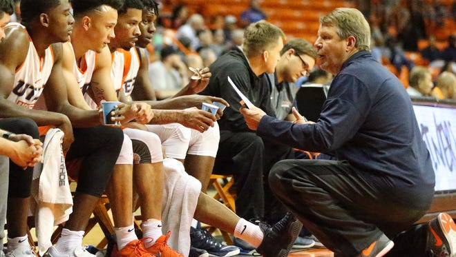 UTEP head basketball coach Tim Floyd talks to the White team during a time out in the Orange and White scrimmage in October in the Don Haskins Center.