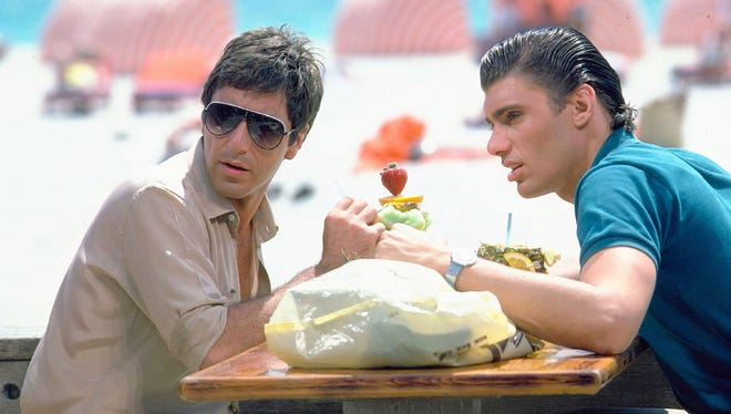 """Al Pacino and Steven Bauer as Tony and Manny on Miami Beach in """"Scarface."""""""