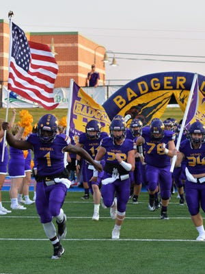 Jonah White (1) leads the Merkel Badgers on to the field prior to a game with Eastland at Shotwell Stadium on Aug. 31, 2017.