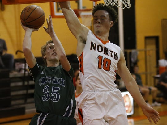 Ben Bosland (35) of Colts Neck  drives to the basket against Sky Cherry (10) of Middletown North during  first round of NJSIAA  tournament boys basketball game at Middletown North High School. Monday, February 27, 2017. Middletown,NJ.   Noah K. Murray-Correspondent/Asbury Park Press  ASB 0228 Boys Hoops NJSIAA Tournament Roundup