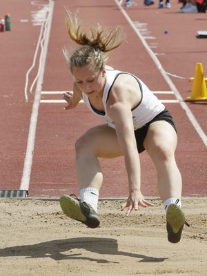 Edgar's Macey Wirkus prepares to land during her triple jump during Division 3 girls competition in the WIAA state track meet Saturday.