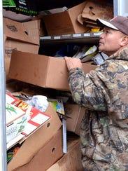 Isimeeli Malupo, 63, loads empty boxes into a truck