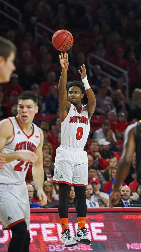 USD's Trey Dickerson (0) takes a shot during a game