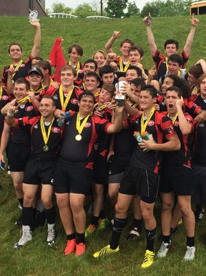 The Rye rugby team celebrates its Division II state championship victory over the Saratoga Mustangs in Utica on June 5, 2016.