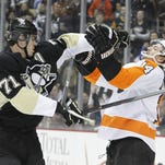 Sean Couturier, right, has played very well against Pittsburgh in his career.