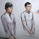 This courtroom sketch made May 1, 2013, shows defendants Dias Kadyrbayev, left, and Azamat Tazhayakov appearing in front of Federal Magistrate Marianne Bowler at the Moakley Federal Courthouse in Boston.