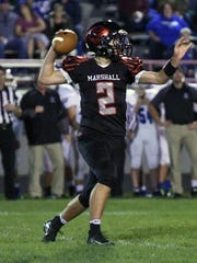 Marshall QB Wyatt Crow (2) drops back to pass during game action Friday night.