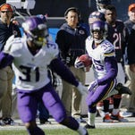 The Minnesota Vikings' Marcus Sherels (35) runs to the end zone for a touchdown on a punt return during the first half of Sunday's game against the Chicago Bears in Chicago.