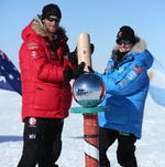 That's Prince Harry on the left and Margaux Mange of Team US as they and their fellow adventurers reach the South Pole  on the Walking With The Wounded charity trek on December 13, 2013 in Antarctica.