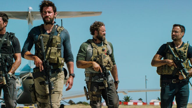 "In this photo provided by Paramount Pictures shows Pablo Schreiber, from left, as Kris ""Tanto"" Paronto, John Krasinski as Jack Silva, David Denman as Dave ""Boon"" Benton and Dominic Fumusa as John ""Tig"" Tiegen, in the film, ""13 Hours: The Secret Soldiers of Benghazi"" from Paramount Pictures and 3 Arts Entertainment/Bay Films. The movie releases in U.S. theaters Jan. 15, 2016. (Christian Black/Paramount Pictures via AP)"