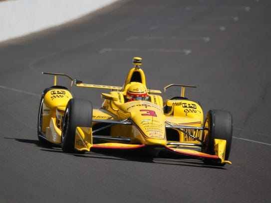 Helio Castroneves (3) drives down the front straightaway