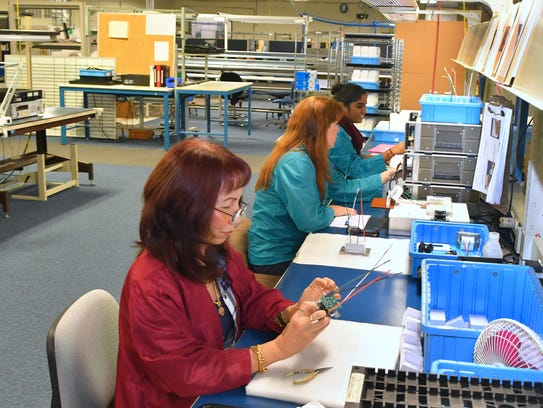 Workers in the Anuva manufacturing production area.