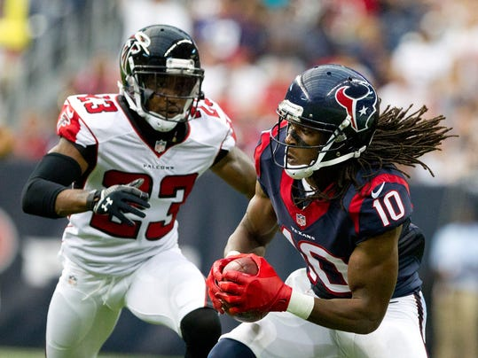Houston Texans wide receiver DeAndre Hopkins (10) catches a pass as Atlanta Falcons cornerback Robert Alford (23) defends in the first quarter of an NFL preseason football game, Saturday, Aug. 16, 2014, in Houston. (AP Photo/Conroe Courier, Jason Fochtman)