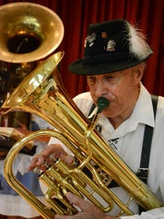 Wes English plays German music on an English baritone horn during an Oktoberfest celebration at St. John the Evangelist Catholic Church in North Naples.