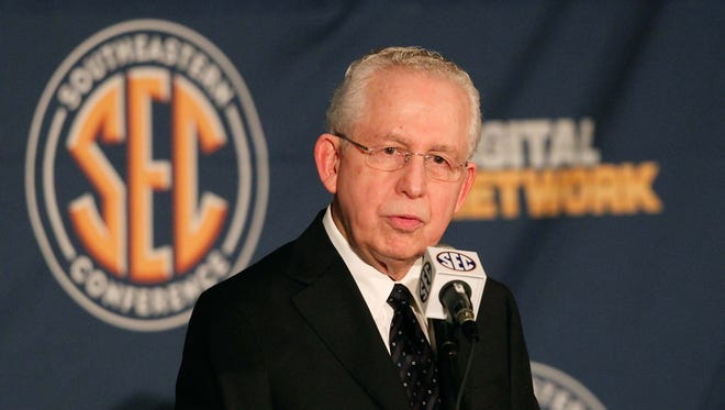 SEC commissioner Mike Slive talks with the media during the 2013 SEC football media days at the Hyatt Regency.