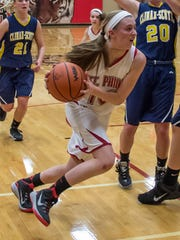 St. Philip's Megan Gordon drives for the basket against
