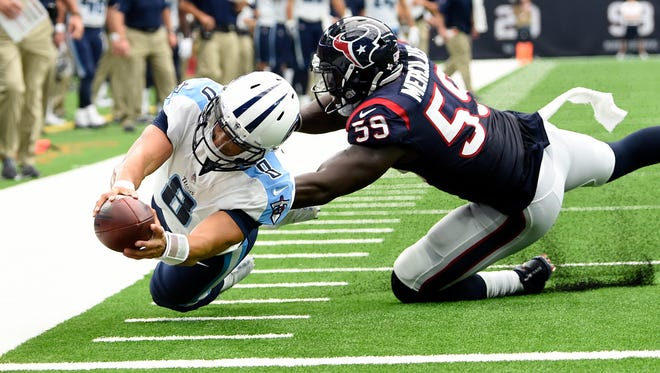 Titans quarterback Marcus Mariota (8) dives for a touchdown during the second quarter at NRG Stadium on Sunday, Oct. 1, 2017.