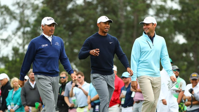 Fred Couples, Tiger Woods and Matt Parziale walk off the 1st tee during a practice round for the Masters golf tournament at Augusta National Golf Club on April 4.