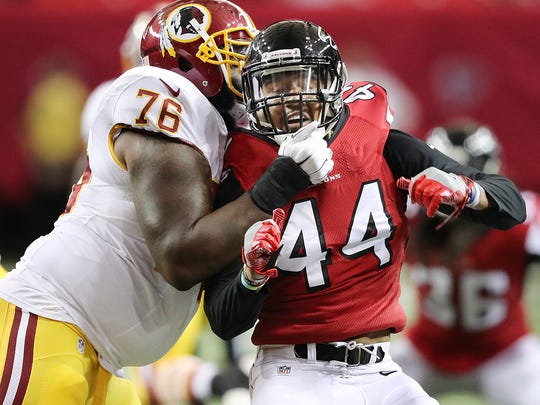 Atlanta Falcons' Vic Beasley Jr. tries to rush against Washington Redskins tackle Morgan Moses during the first half of a preseason NFL football game Thursday, Aug. 11, 2016, in Atlanta.