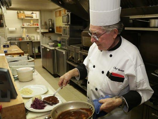 Chef Bernard Kurzawa plates sauerbraten at Bernard's