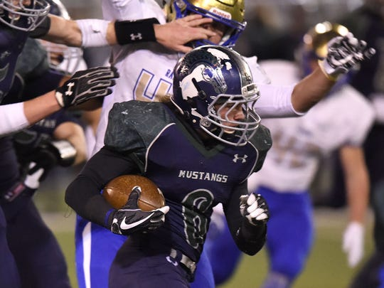 Damonte's Ryon Hurley carries the ball against Reed in Friday's playoff game.