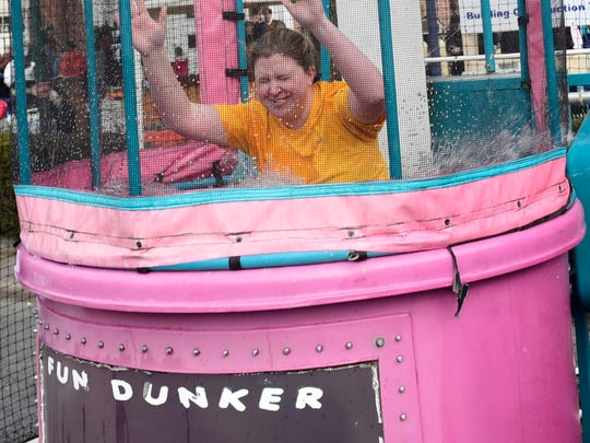 Rebecca Holder goes down in the dunk tank. Crowds are