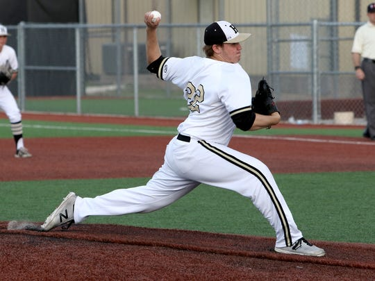 Henrietta's Weston Max pitches against Holliday Tuesday, April 17, 2018, in Henrietta.
