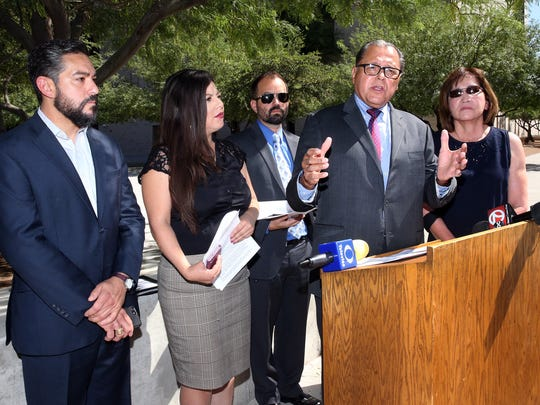 """State Sen. José Rodríguez, second from right, speaks with other members of El Paso's state legislative delegation in front of the Armendariz Federal Courthouse in Downtown El Paso at a news conference Tuesday in which they condemned the """"zero tolerance"""" policy on undocumented immigration announced by the Justice Department. Other legislators are from left: state Reps. César Blanco, Mary González, Joe Moody and Lina Ortega, far right."""
