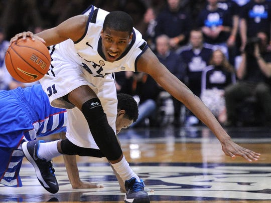 Butler forward Kameron Woods grabs a loose ball against DePaul inside Hinkle Fieldhouse, Thursday, January 9, 2014, in Indianapolis.