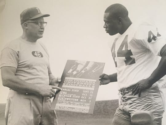 Neptune native Nate Ramsey (right) and Indiana coach Phil  Dickens talk in 1962, when Ramsey was a wingback and team captain for the Hoosiers.
