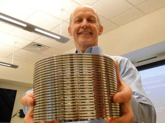 Roger Peery, CEO and principal hydrologist for John Shomaker and Associates, Inc., holds a stainless steel wire-wrapped screen that allows water to be pulled into a well and pumped to the surface, but blocks most sand from getting into the well.