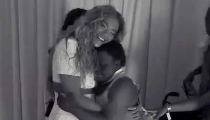 Beyonce greets a fan.