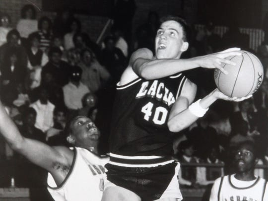 Lacey's Chris Fleming drives to the basket in a 1988 game.
