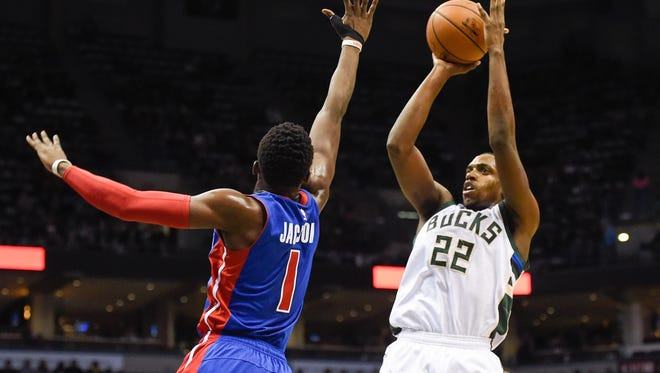 Bucks guard Khris Middleton (22) takes a shot against Pistons guard Reggie Jackson (1) in the fourth quarter of the Pistons' win Saturday in Milwaukee.