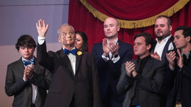 Bill Murray arrives at his seat before the 19th annual Mark Twain Award for American Humor program at the Kennedy Center.