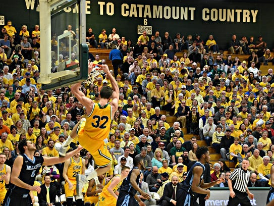Ethan O'Day throws down a dunk in UVM's win over Maine